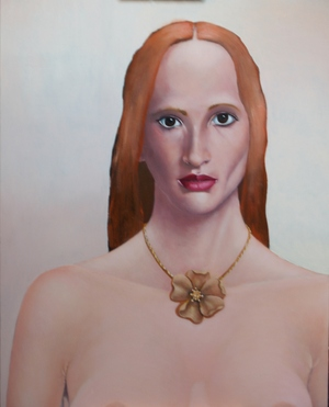red haired girl with bronze flower